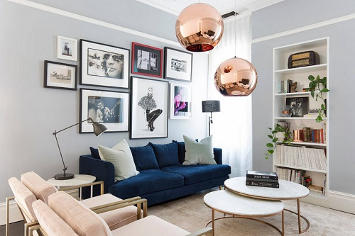 An image of a chic modern living room. The nesting tables in the center are pulled only slightly apart.