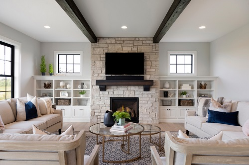 An image of a traditional living room. The nesting table in the center is a bit small for the space pushed together, but can accommodate two zones of seating when pulled apart.