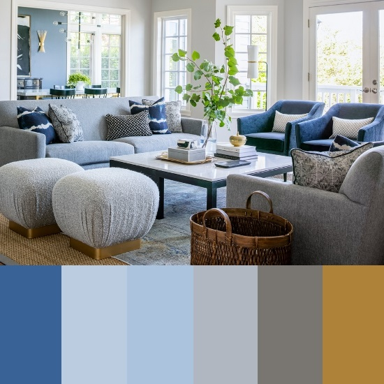 An image of a living room decorated in blue and gray. Along the bottom edge is a swatch sampling the prominent colors used in the room