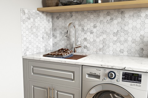 An image of a laundry sink with a wooden board fitted to site on the lip of the sink, creating a surface level with the surrounding counter.